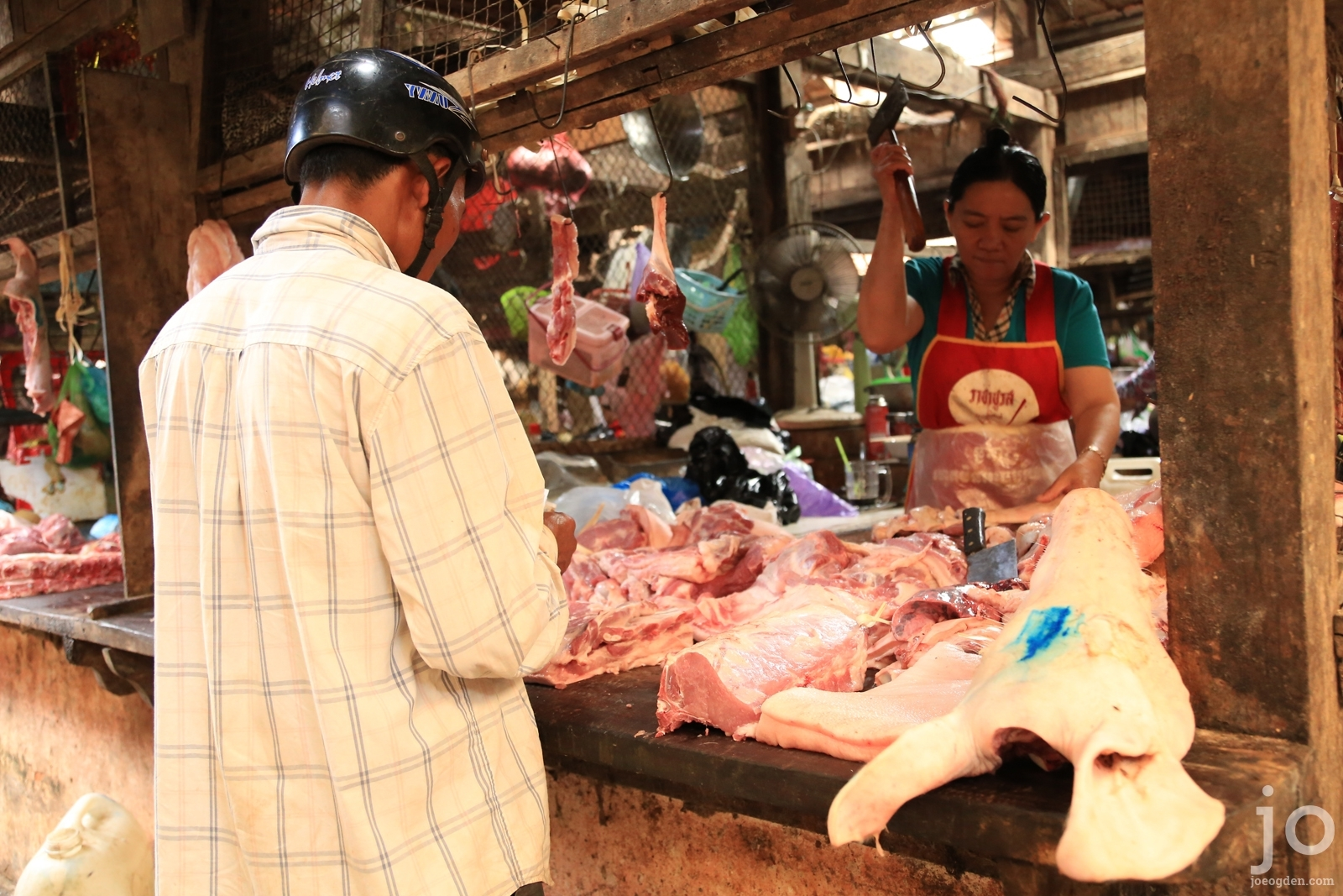 Butcher at Kampot market, Cambodia